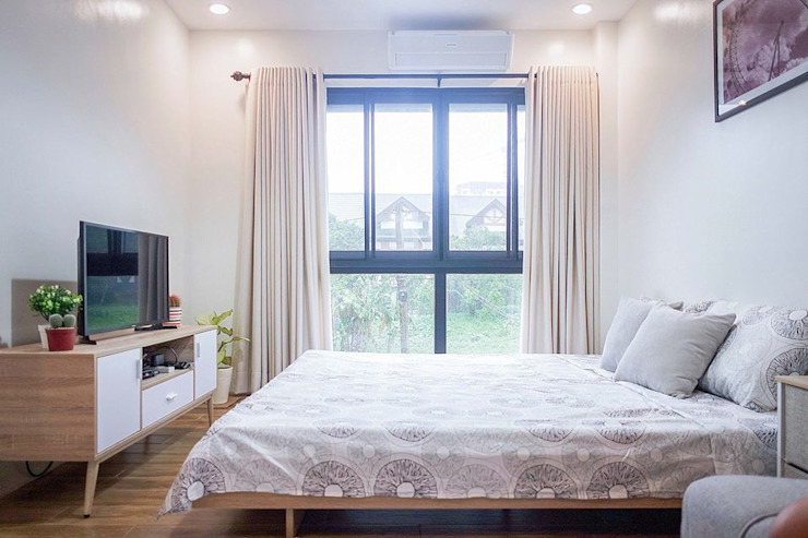 The master bedroom is also minimally designed to suit the modern Scandinavian theme Scandinavian style bedroom by JAAL Builders Scandinavian