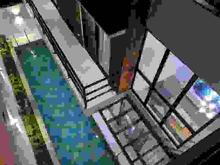 View of pool from master bedroom balcony by JAAL Builders Scandinavian