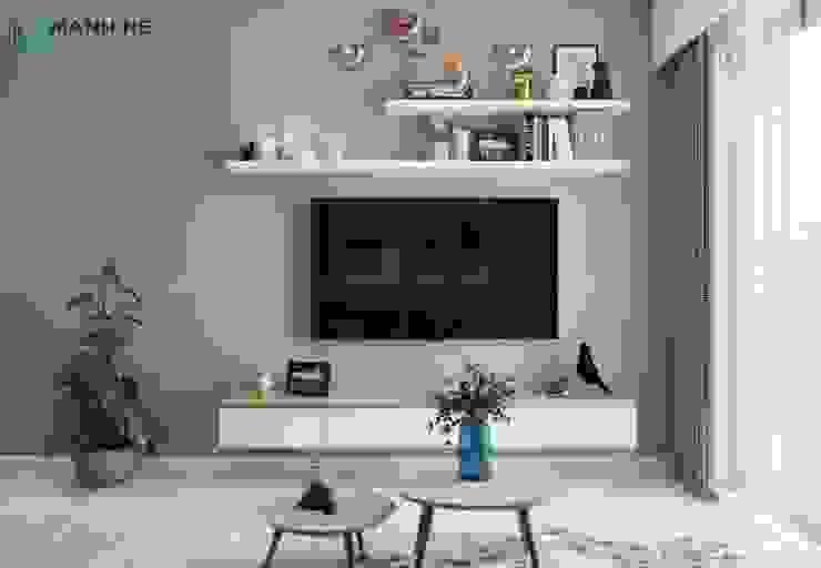 Kệ tivi treo tường phòng khách đơn giản. Thiết kế thêm hộc tủ để chứa đồ tiện dụng bởi Công ty TNHH Nội Thất Mạnh Hệ Hiện đại