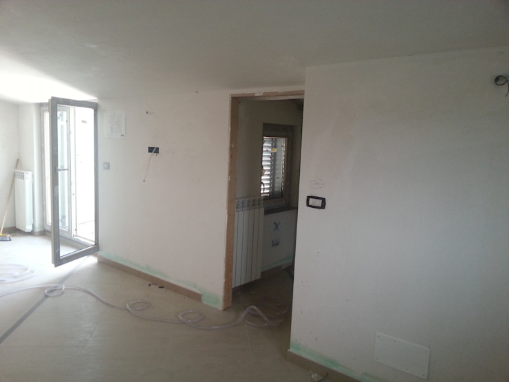 Foto Cantiere_piano superiore_living di antonio felicetti architettura & interior design Moderno