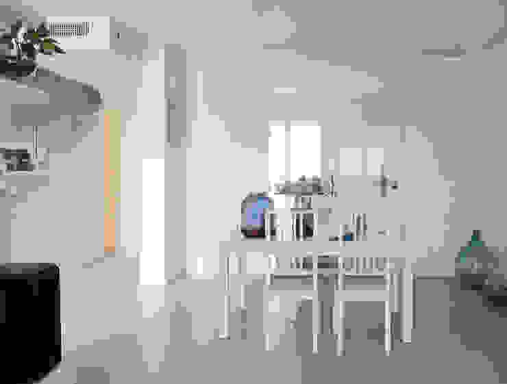 la sala da pranzo Studio Dalla Vecchia Architetti Sala da pranzo moderna
