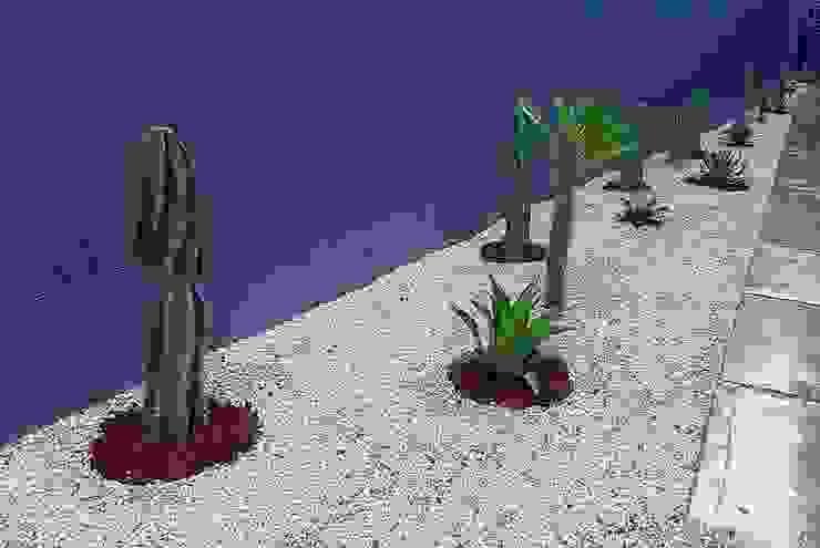 Jardín semidesértico con muro gris EcoEntorno Paisajismo Urbano Jardines japoneses