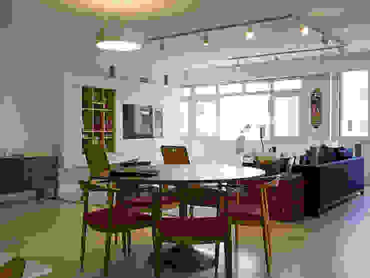 Salon - comedor_Apto. Venezia l Tea Arquitectos Salas de estilo moderno Blanco