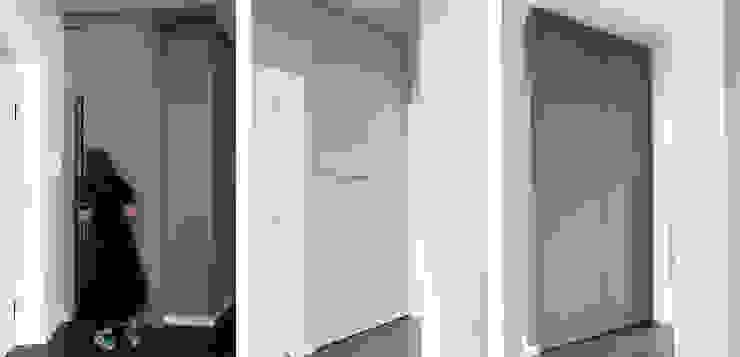 Di Origine Progettuale DOParchitetti Flur, Diele & TreppenhausAufbewahrungen Holz Mehrfarbig