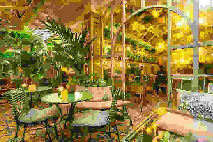 CONSTRUCCIONES HERGAF S.A. Soggiorno in stile tropicale