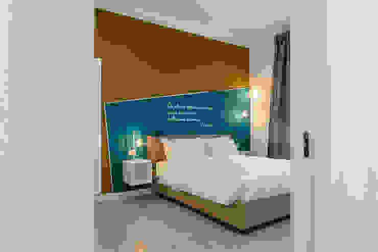 Stanza da letto_dopo antonio felicetti architettura & interior design Camera da letto moderna Legno Giallo