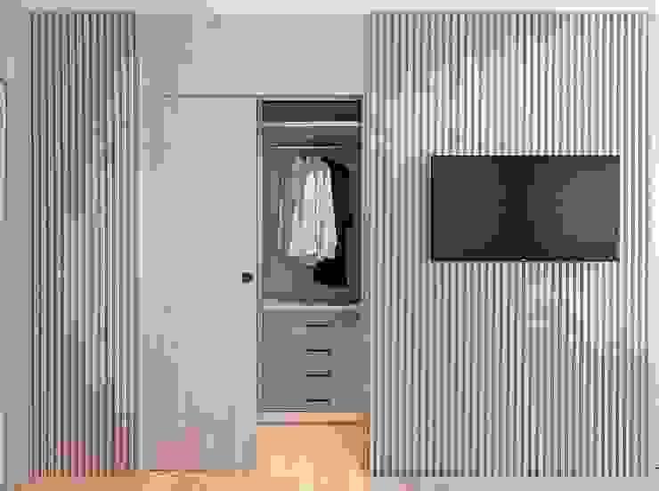 Vestidor integrado en el dormitorio principal Vestidores de estilo moderno de MANUEL GARCÍA ASOCIADOS Moderno