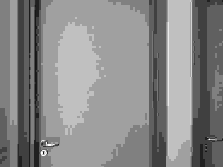 NUOVI UFFICI E CAPANNONE INDUSTRIALE Spazi commerciali moderni di antonio felicetti architettura & interior design Moderno Legno Effetto legno