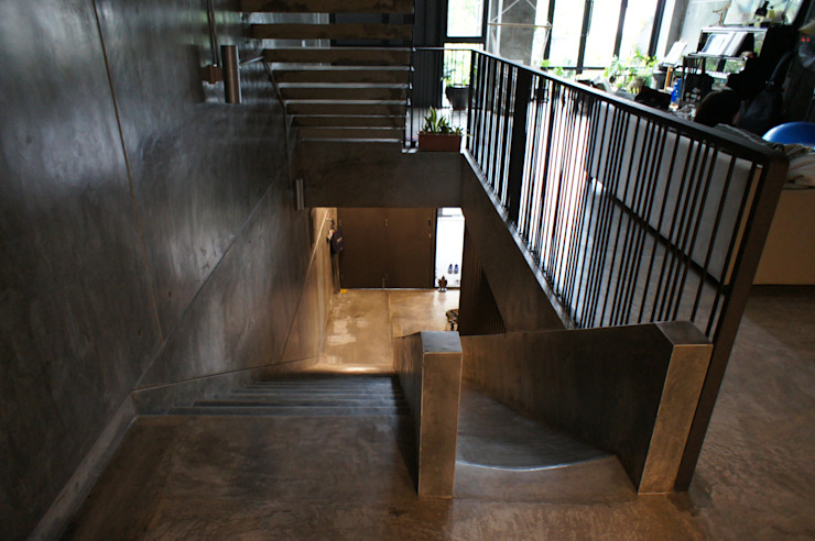 A slide was introduced next to the staircase, introducing a playful feature for kids N O T Architecture Sdn Bhd Stairs
