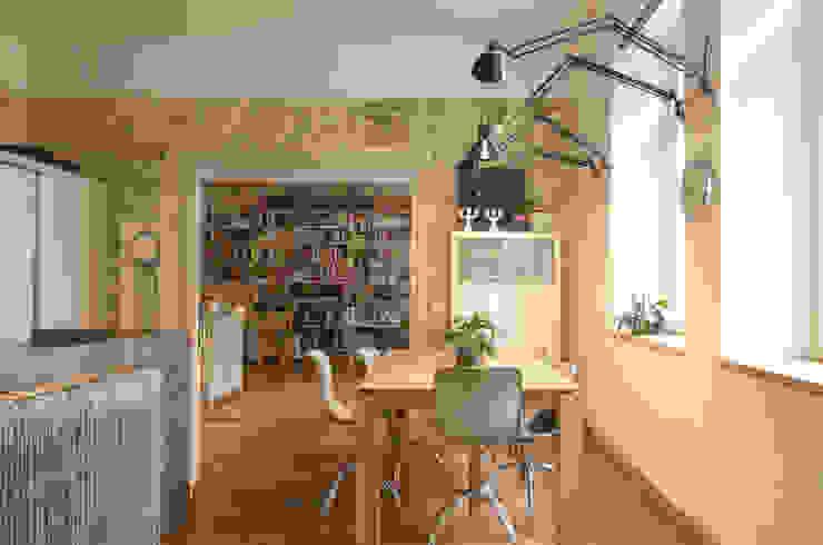 Zona living Angela Baghino Sala da pranzo eclettica Legno massello