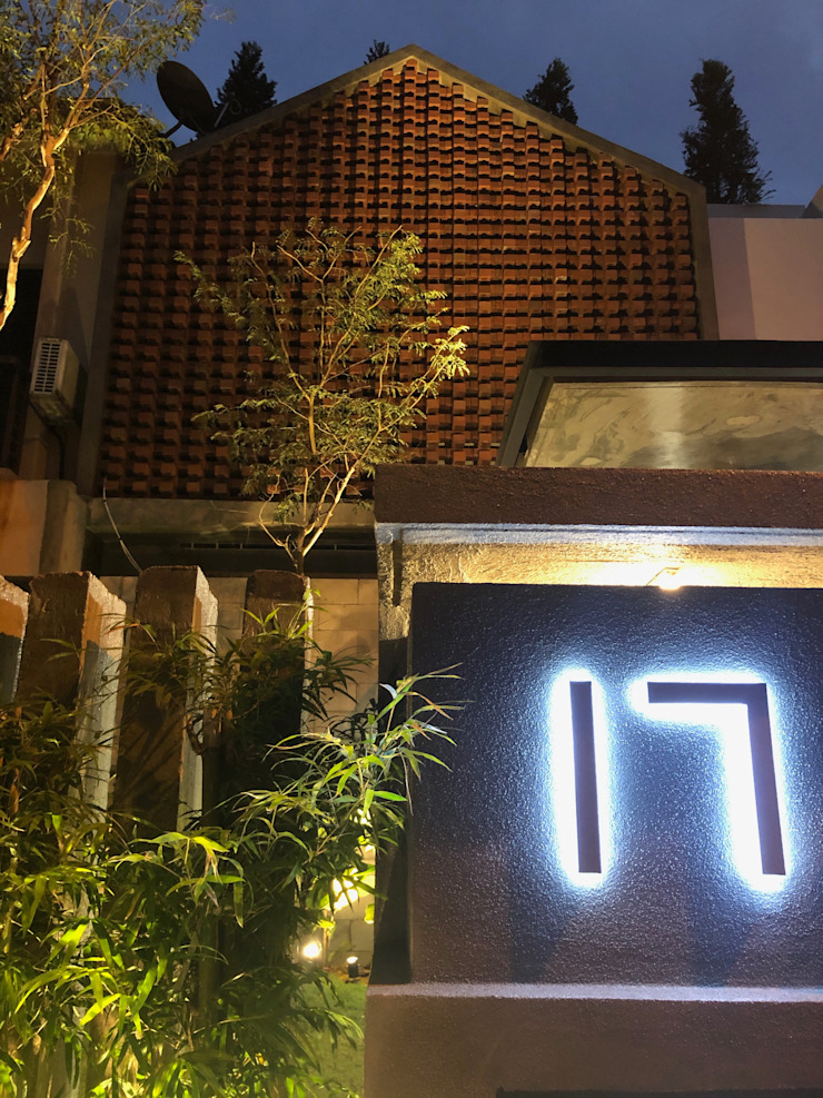 Combination of red bricks, concrete and lightweight blocks, creating catchy visual effects to the frontage N O T Architecture Sdn Bhd Terrace house