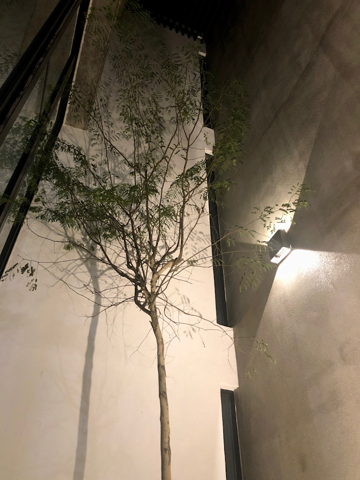 Internal courtyard in night view N O T Architecture Sdn Bhd Modern style balcony, porch & terrace