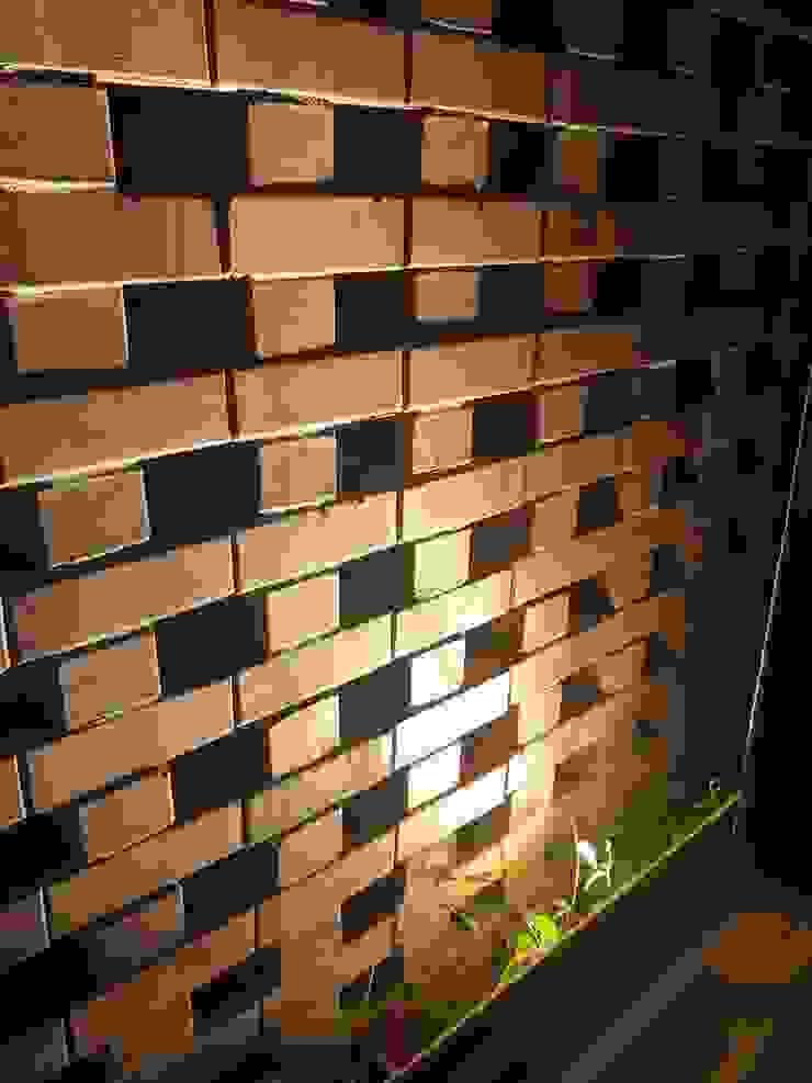 Red bricks arrangement N O T Architecture Sdn Bhd Rustic style walls & floors