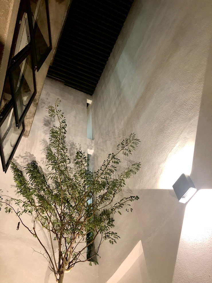 Courtyard in night view N O T Architecture Sdn Bhd minimalist style balcony, porch & terrace