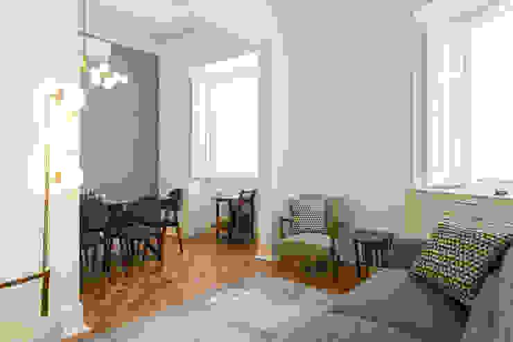 Sala comum - zona de estar e refeição por homify Moderno