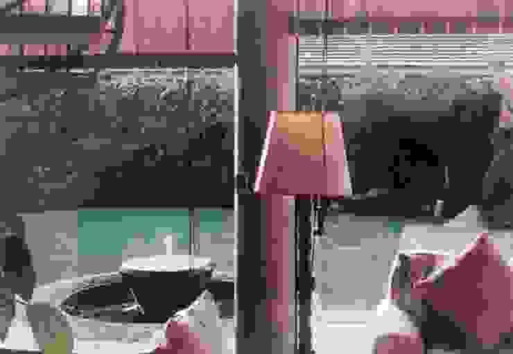 Detalle de Sala, con vidro templado, doble altura y vista a terraza, fuente y Járdin posterior Arechiga y Asociados Salones minimalistas Vidrio Transparente