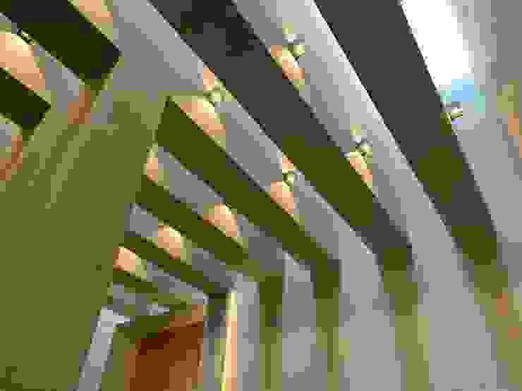 homify Modern Corridor, Hallway and Staircase Limestone Beige