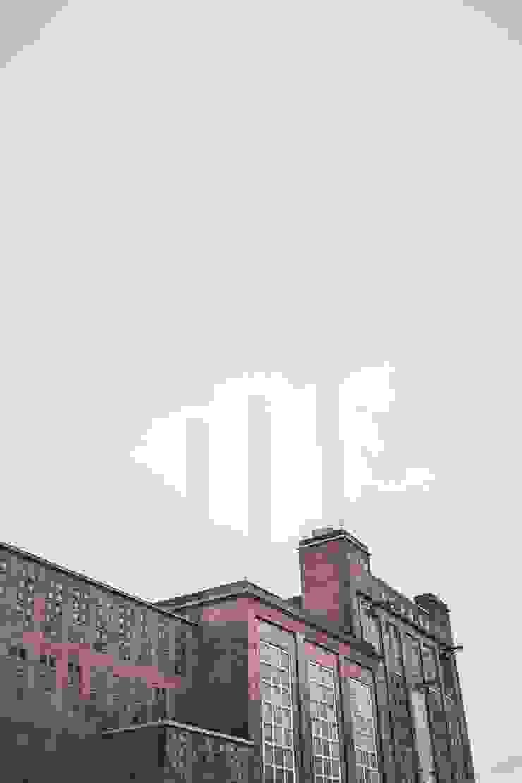 Floorwell Casas de estilo industrial