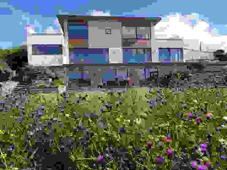 Three Storey subterranean new build property. Arco2 Architecture Ltd Detached home