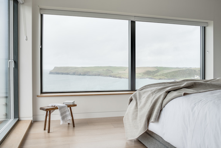 Sea views from the bedroom window Arco2 Architecture Ltd Modern style bedroom