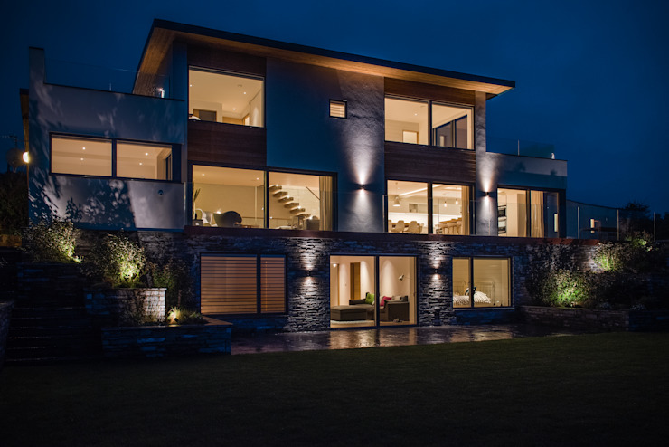 Contemporary seaside new build interior and exterior lighting. Arco2 Architecture Ltd Detached home