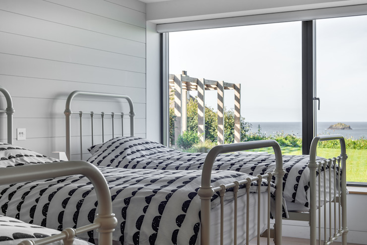 Bedrooms with a sea view Arco2 Architecture Ltd Modern style bedroom