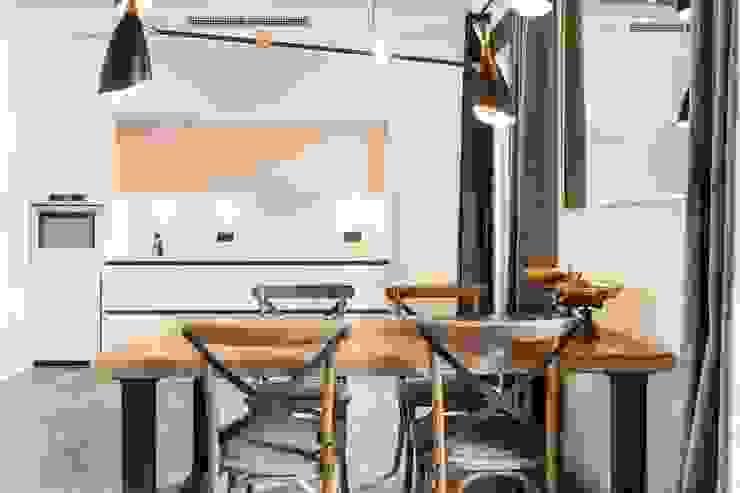 REFORMA INTEGRAL PISO ARIBAU Vb Reformas Integrales Rustic style dining room
