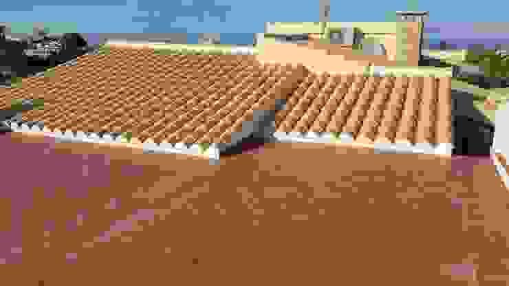 Hemme & Cortell Construcciones S.L. Hipped roof Bricks Beige