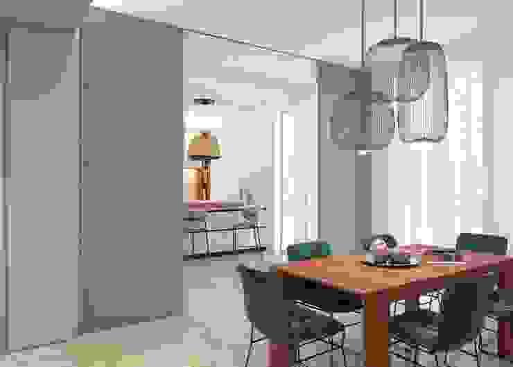 Una vista della cucina dalla zona pranzo arch. Lorenzo Criscitiello Sala da pranzo moderna Blu