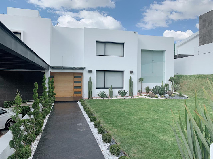 G._ALARQ + TAGA Arquitectos Modern home