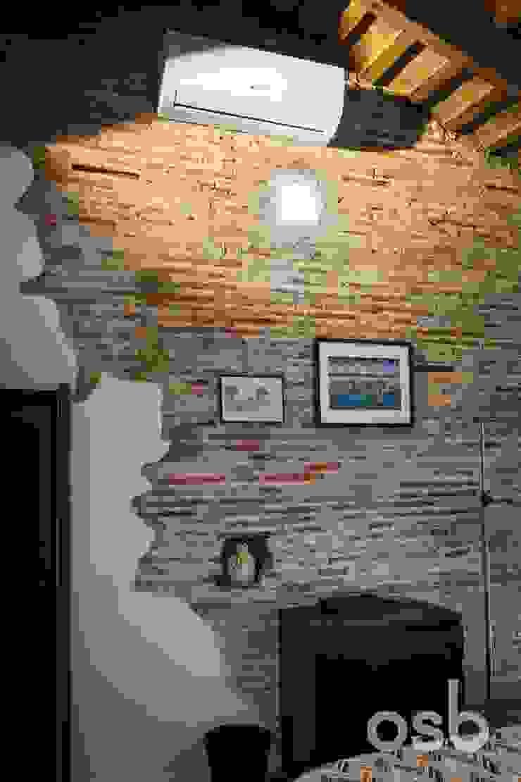 acabados paredes osb arquitectos Paredes y suelos de estilo rústico