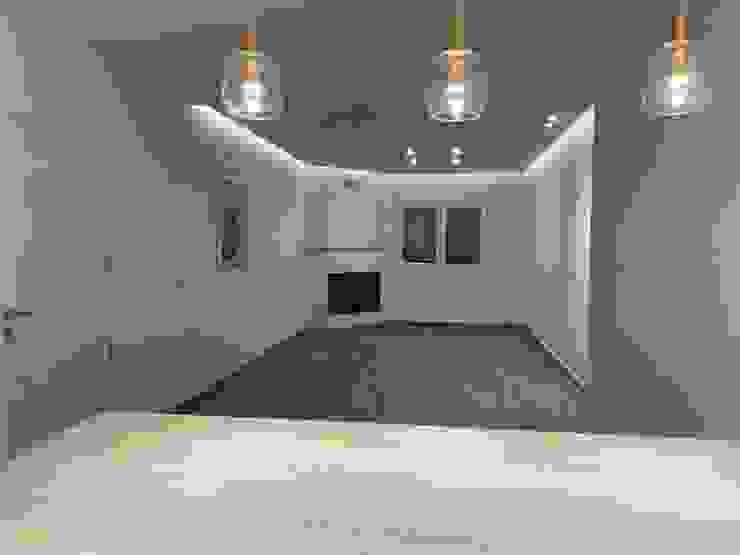 Zona salón desde cocina Techluz Iluminación Salones de estilo moderno