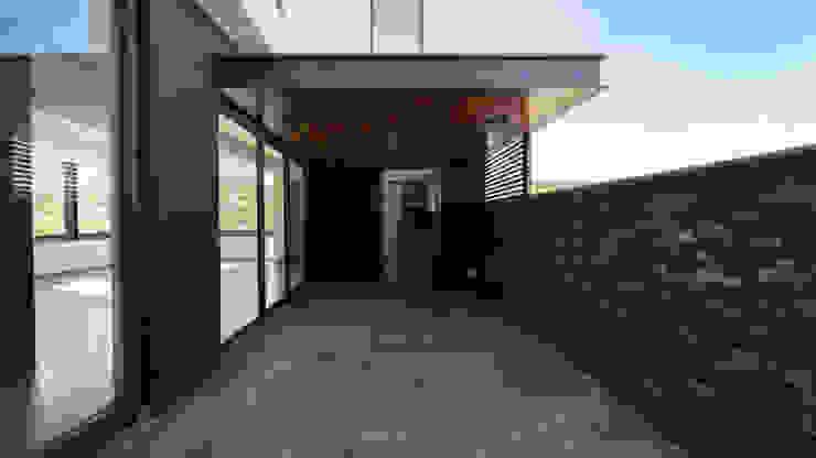 Terraza GRUPO VOLTA Balcones y terrazas modernos Piedra Gris