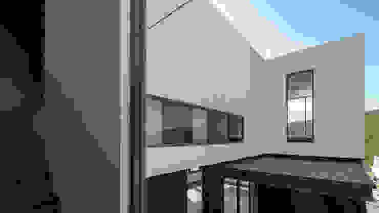 Vista al subir las escaleras. GRUPO VOLTA Paredes y pisos de estilo moderno Vidrio Blanco