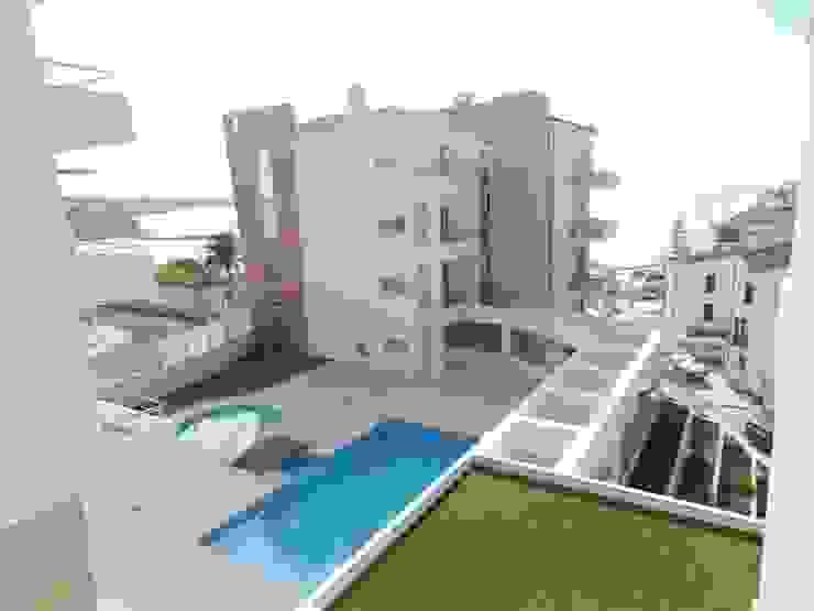 Condomínio Fechado com Piscina a 100m da praia Marvic Projectos e Contrução Civil
