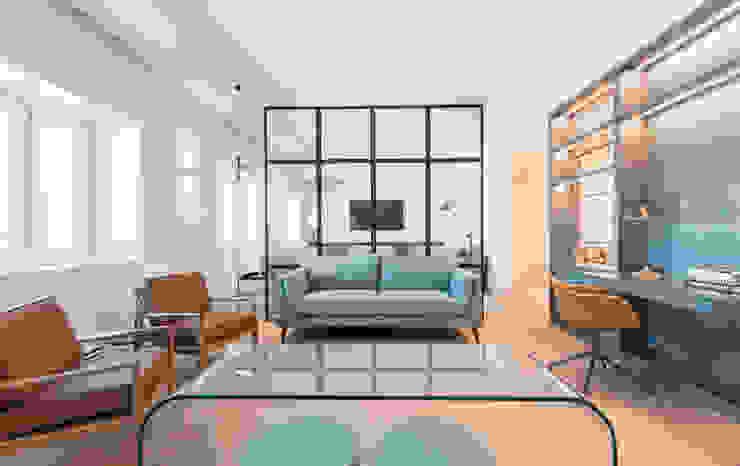 Casa das Estantes blaanc Salas de estar modernas