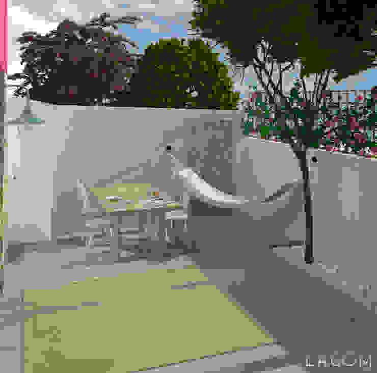 Pátio Lagom studio Varandas, marquises e terraços escandinavos Betão Cinzento