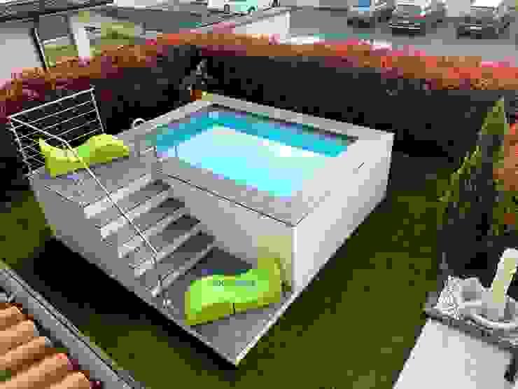 Piscina fuori terra in poco spazio, rivestita in WPC grigio e bianco Aquazzura Piscine Giardino con piscina