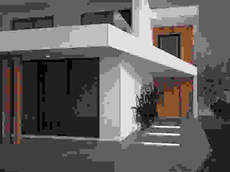 Helder Calça Designer de Interiores Villas Acabado en madera