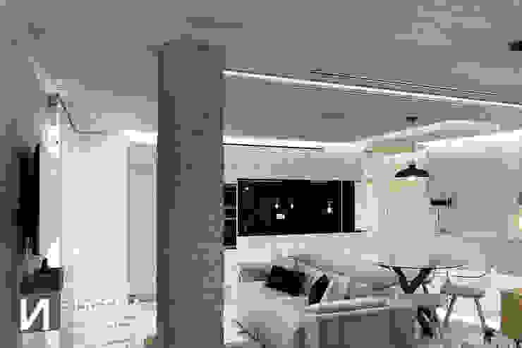 Salón-Cocina DISENA studio Salones de estilo minimalista