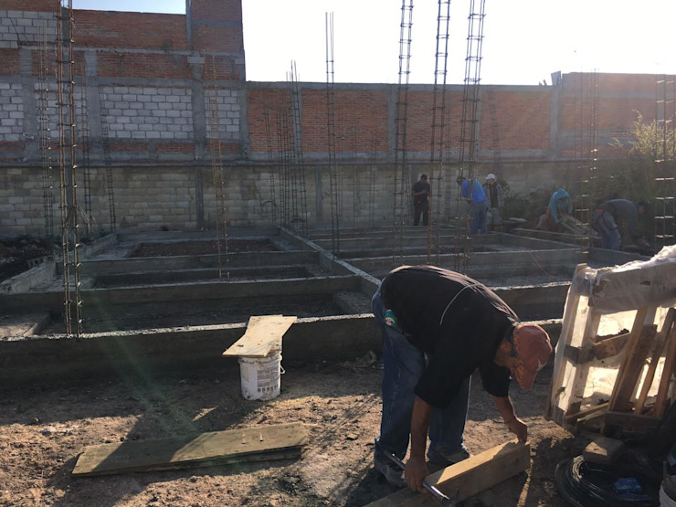 Cimentación Quick BEE Paredes y suelos de estilo moderno