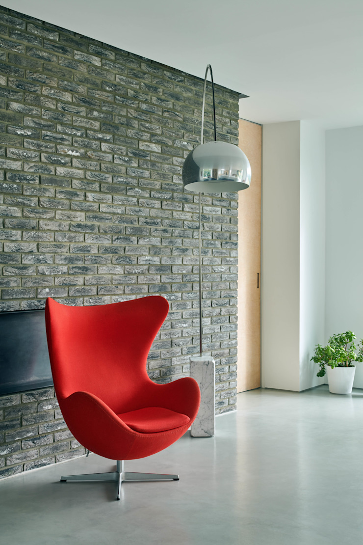 Hearth wall and egg chair Brown & Brown Architects Detached home