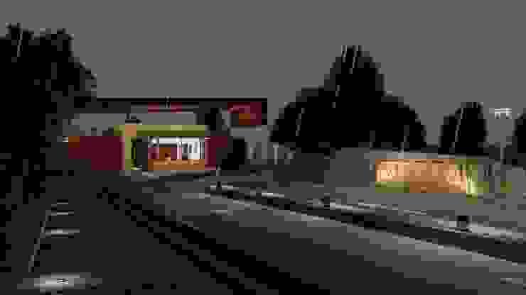 Vista Nocturna Fachada Acceso CONCEPTUAL ESTUDIO + ARQUITECTURA SAS Casas modernas Piedra Beige