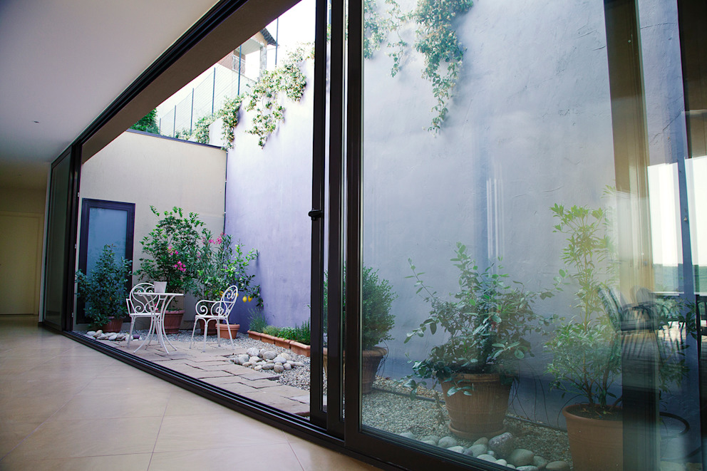 Country style conservatory by GAP Studio Country