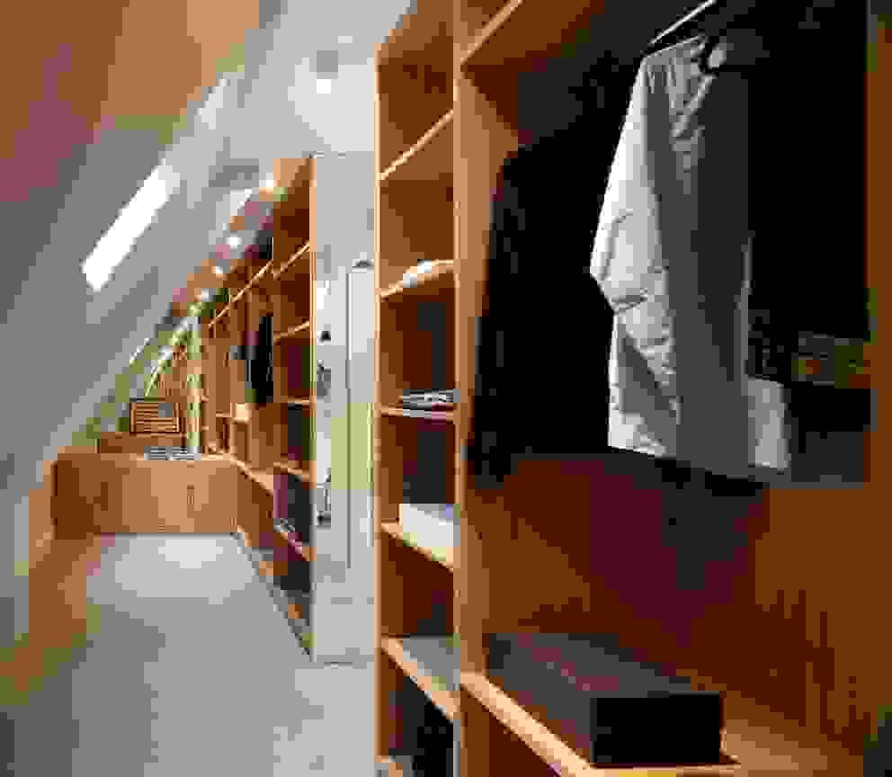 Closets  por TG Studio , Moderno