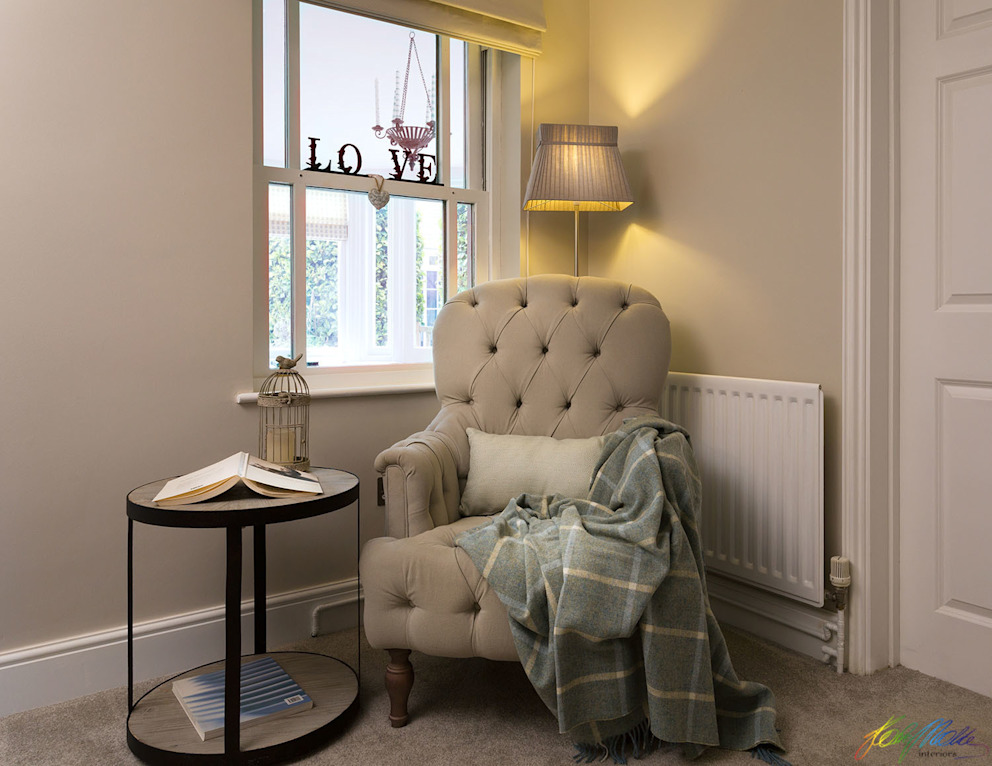 Reading corner with cozy armchair Katie Malik Interiors Living room