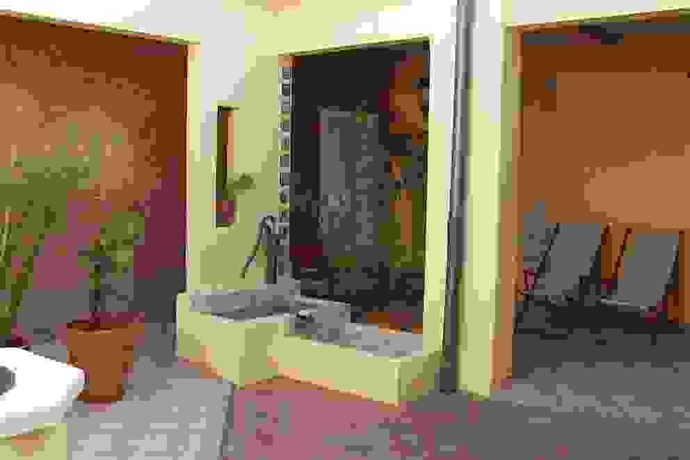 Giardino in stile rustico di milena oitana Rustico