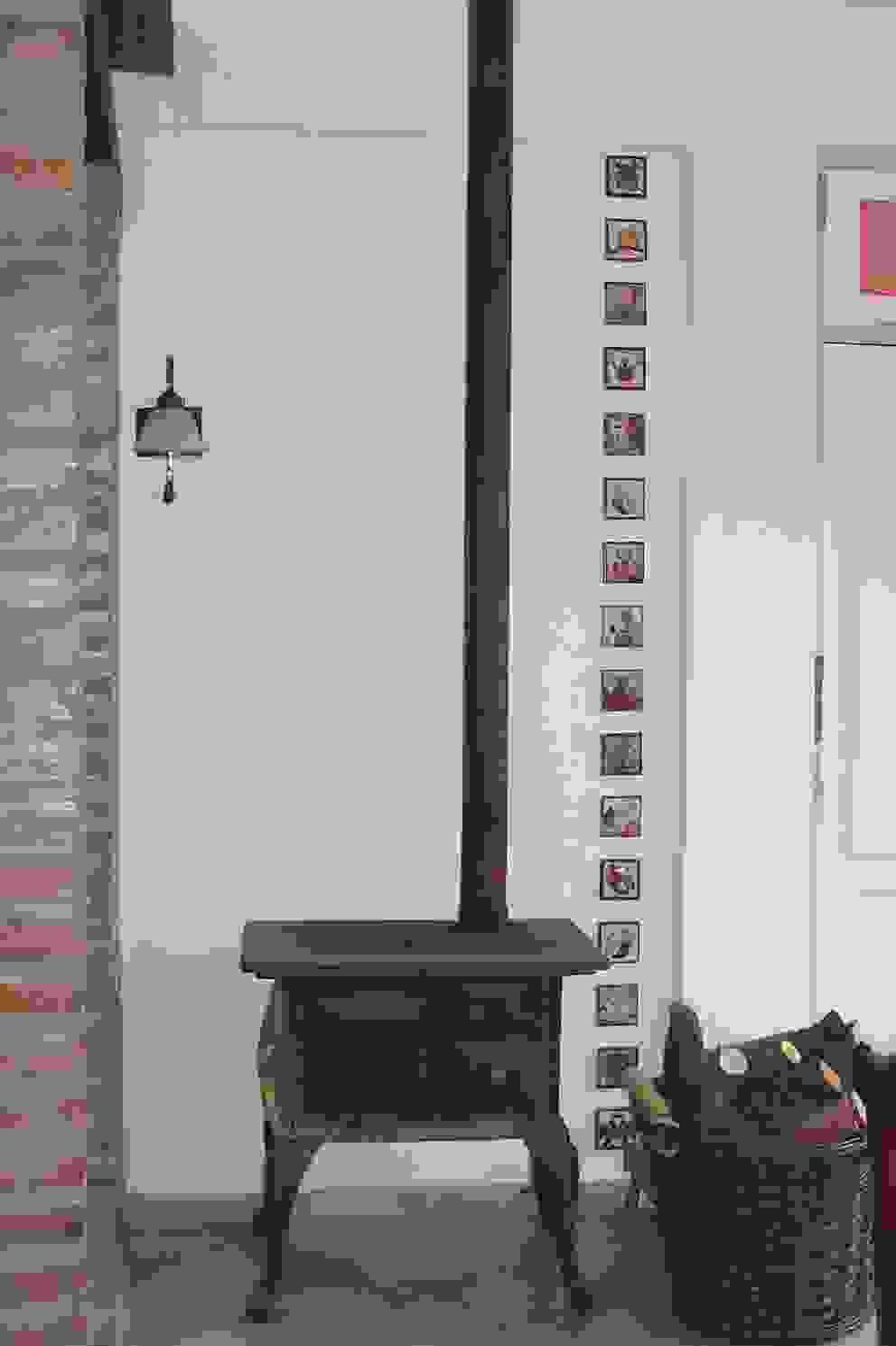 Sala da pranzo in stile rustico di milena oitana Rustico