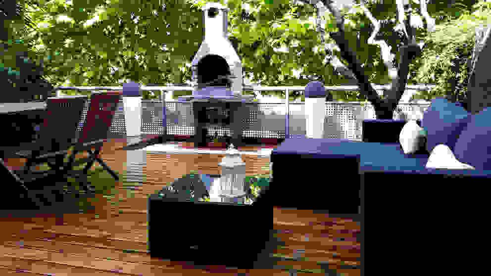 Balcones y terrazas de estilo rústico de Quercus Jardiners Rústico