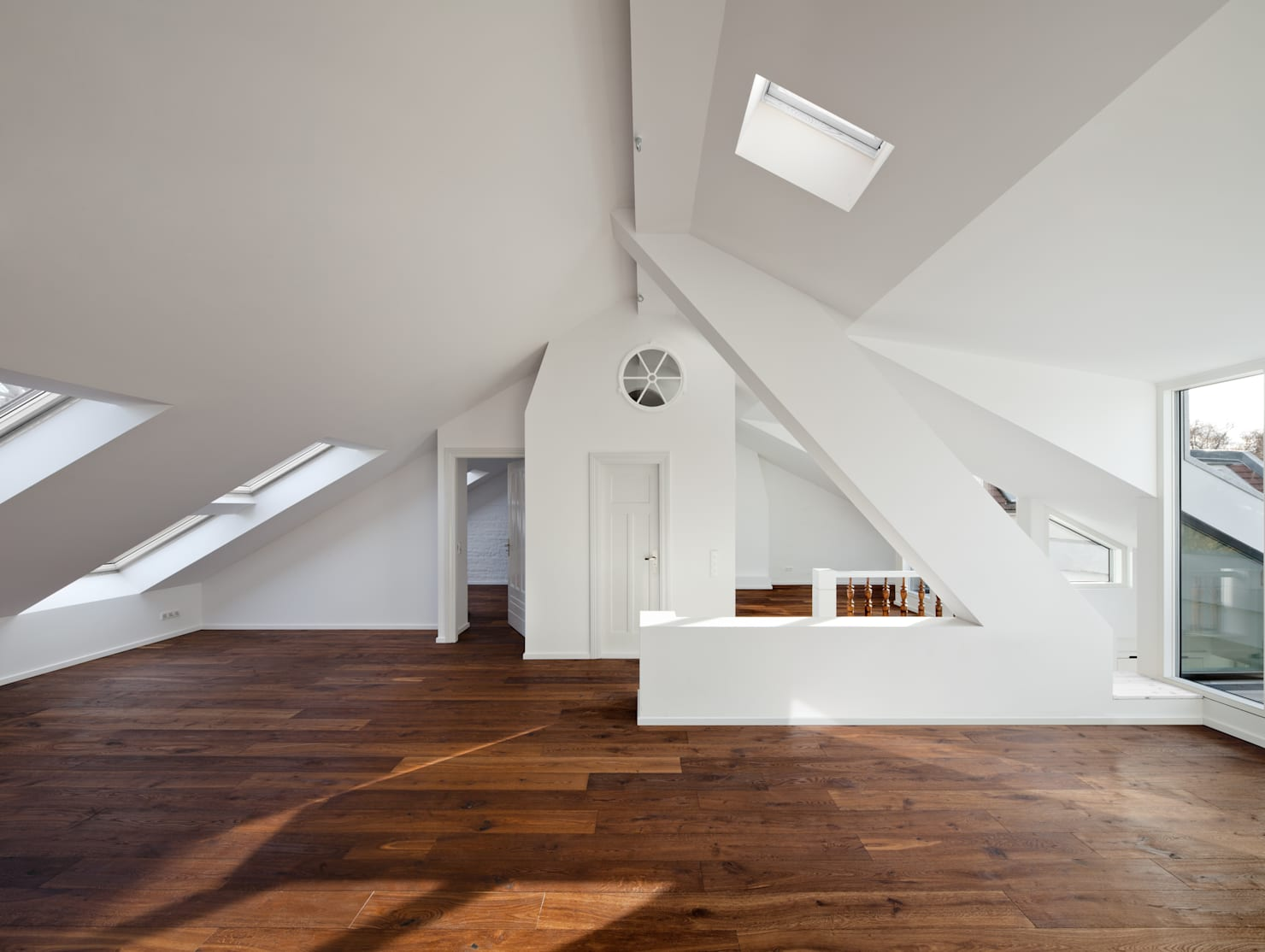 A stunning wood and white attic loft